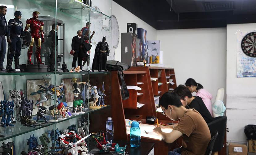 Three artists hard at work at Thundray, an animation studio based in Shanghai, July 27, 2016. Yin Yijun/Sixth Tone