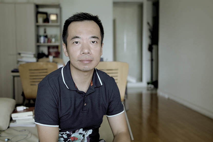 John Wu poses for a photo in his Shanghai home, Aug. 6, 2016. Andy Boreham/Sixth Tone